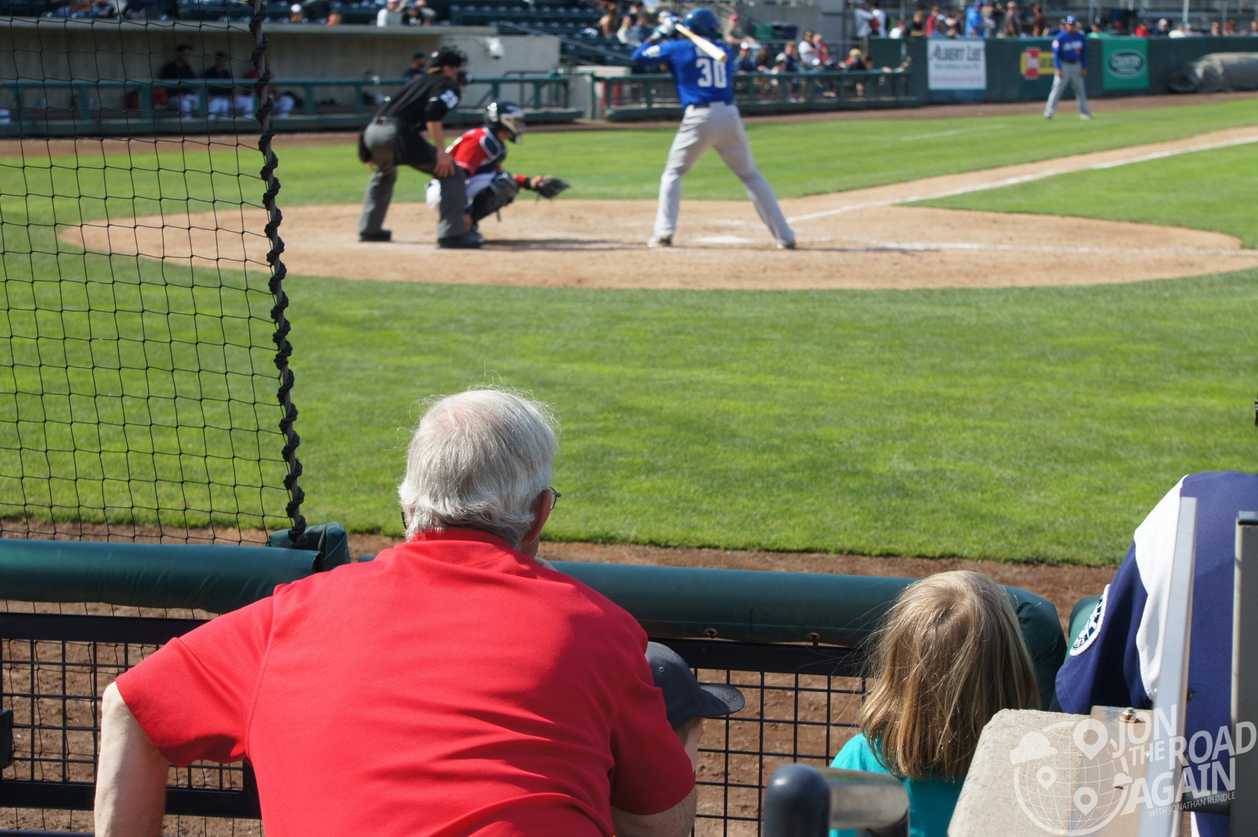Rainiers Staff help the kids get a baseball