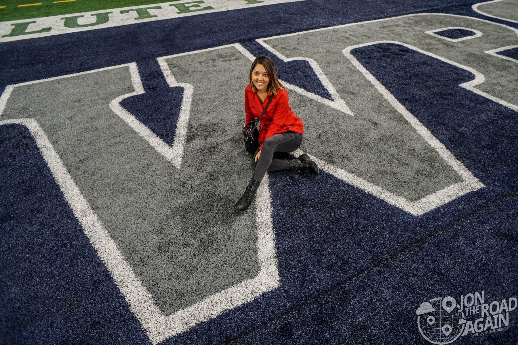 Whitney poses with the W in the endzone