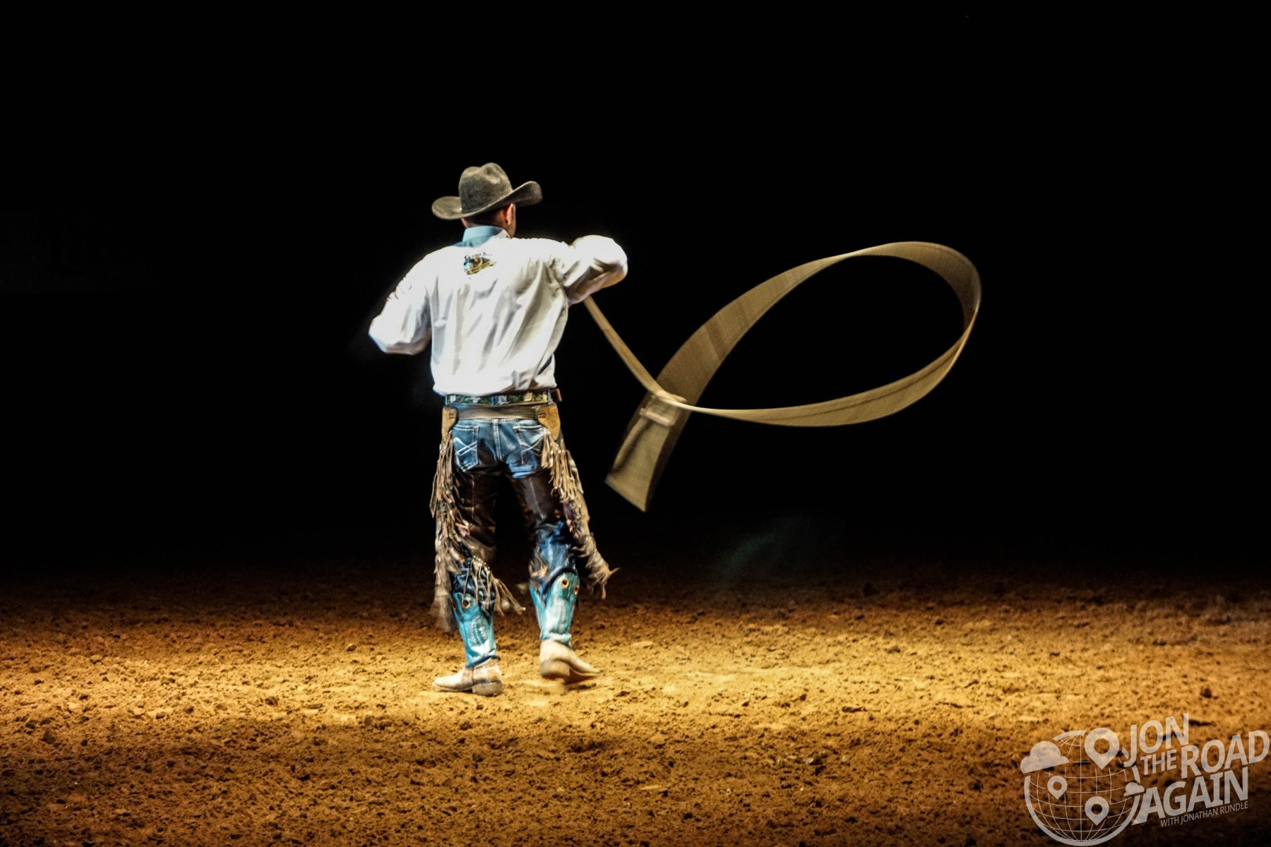 Cowboy doing lasso tricks