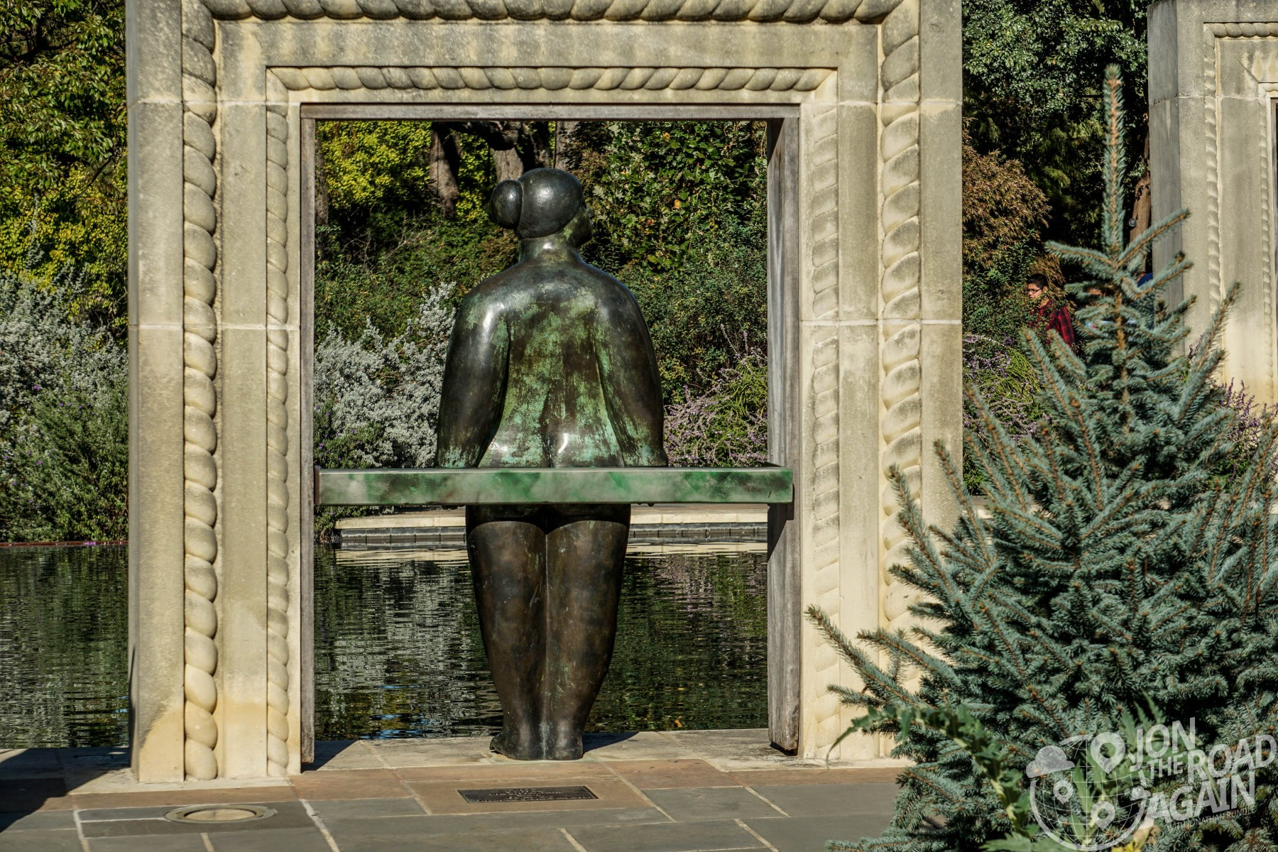 Sculpture in A Woman's Garden and the reflecting pool
