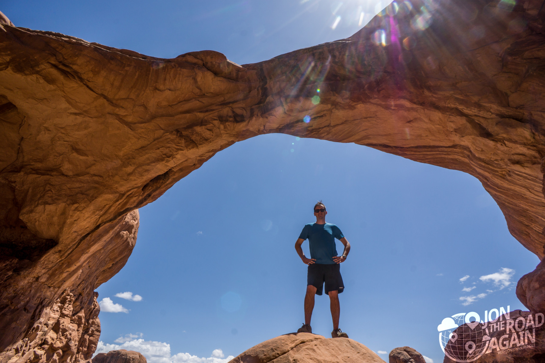 posing under double arch