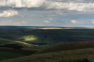 Columbia River Gorge with sun and windmills