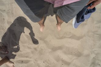 Toes in the sand at Manhattan Beach