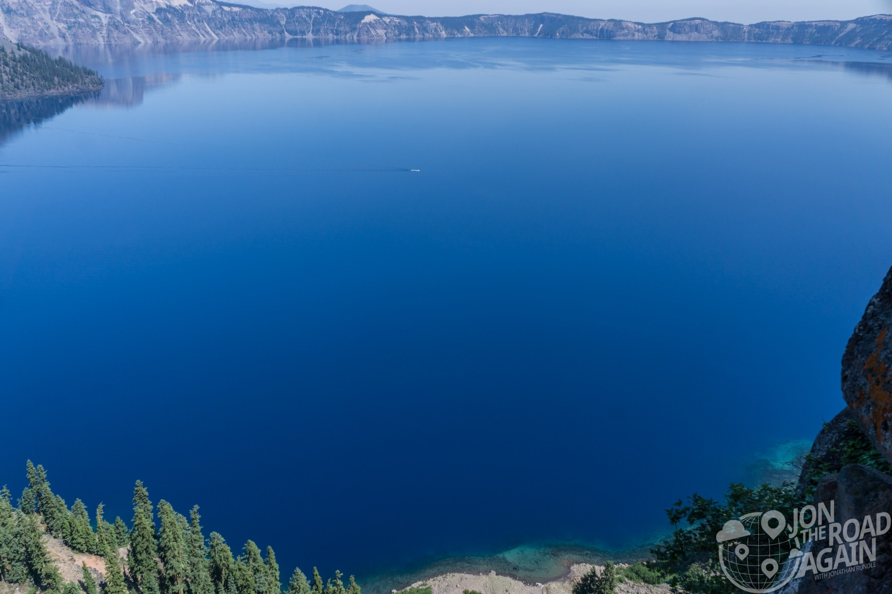 crater lake blue and boat