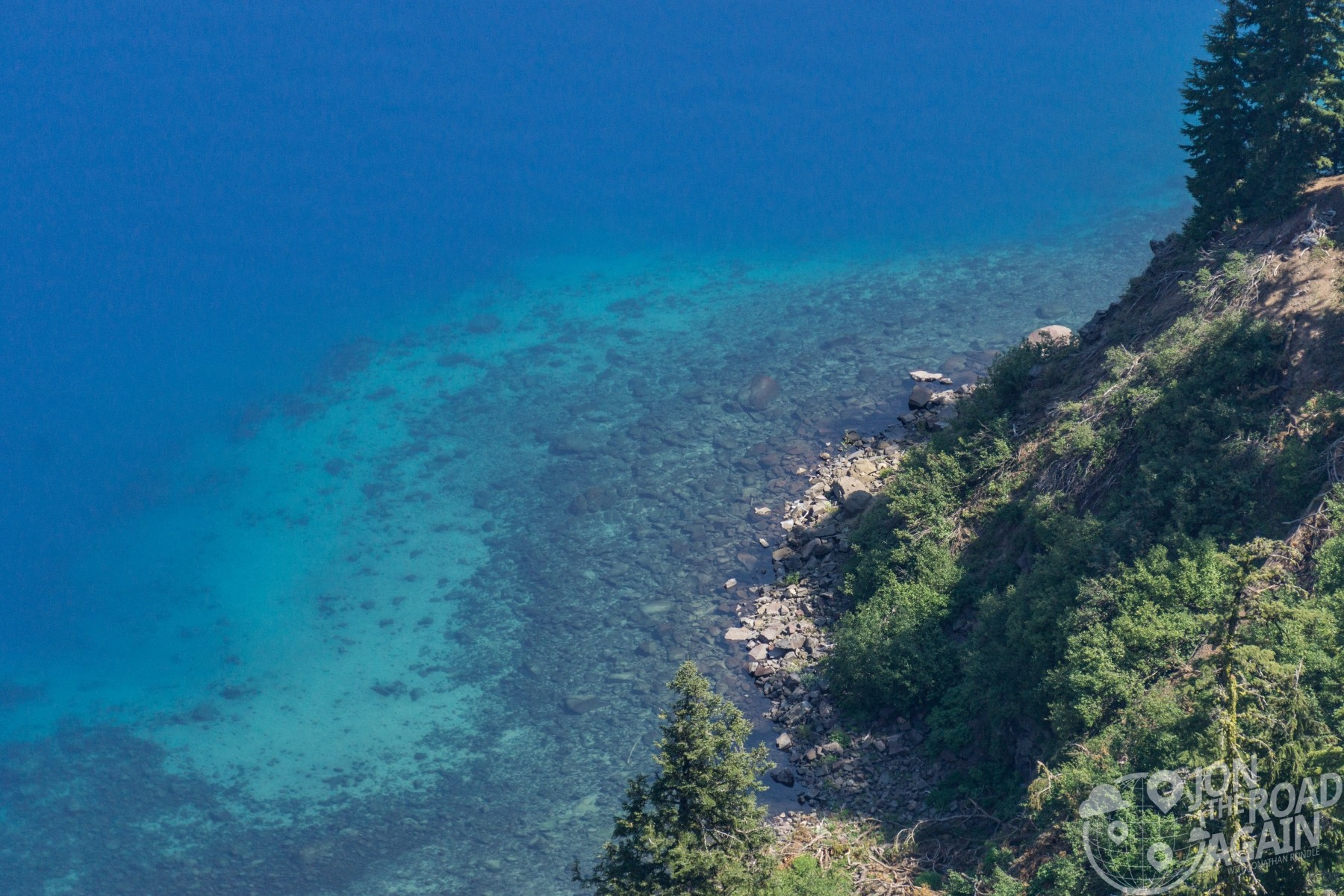clear blue water of crater lake