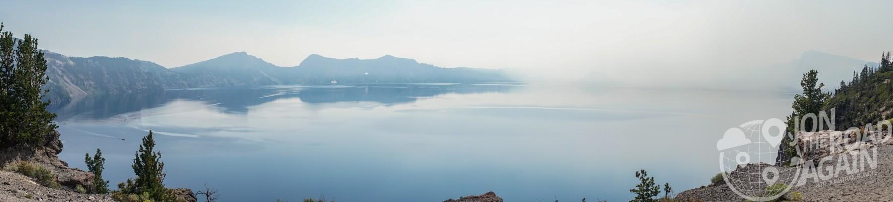 crater lake panorama with smoke