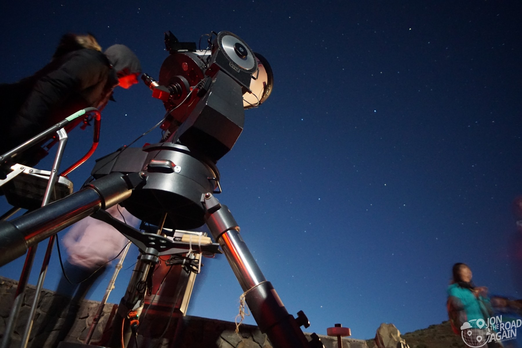 Looking through a telescope at Mauna Kea