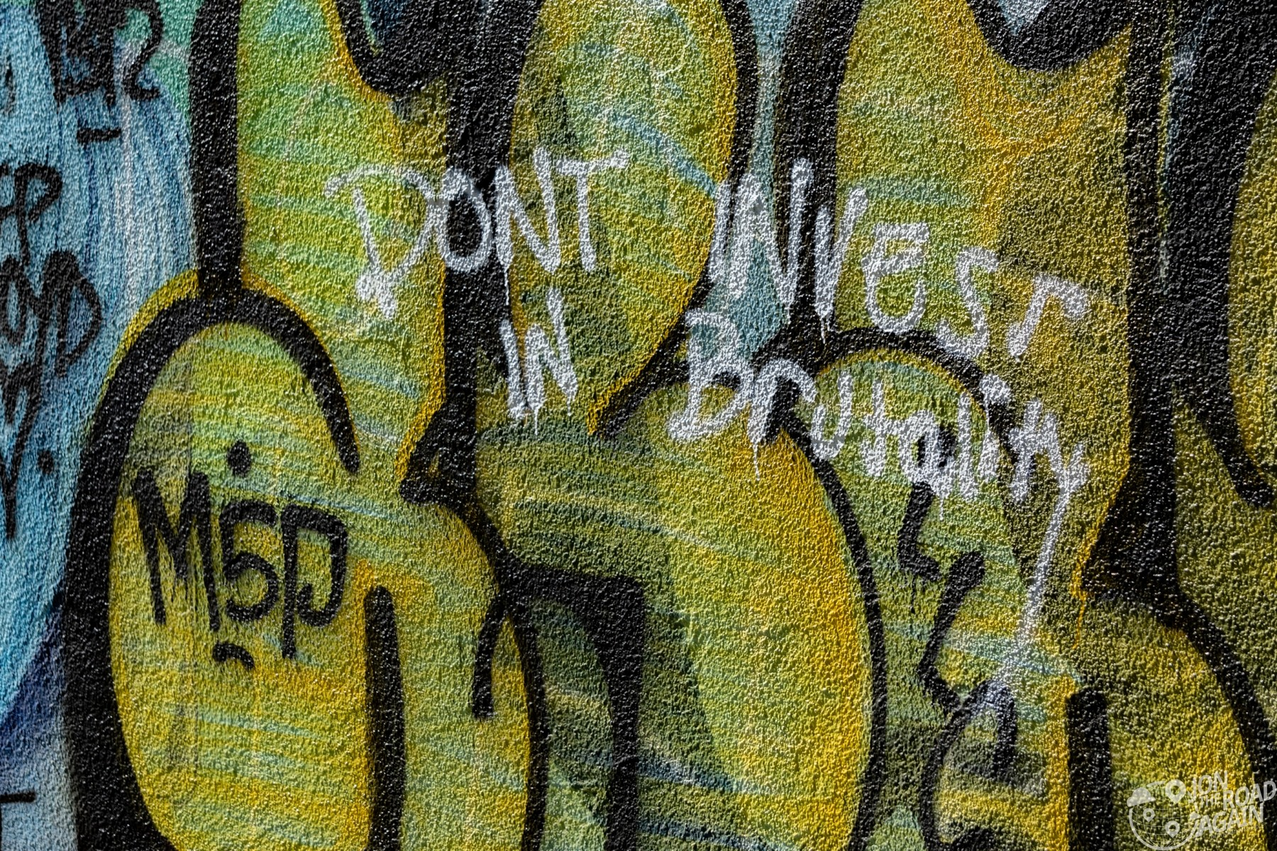 Don't Invest in Brutality graffiti