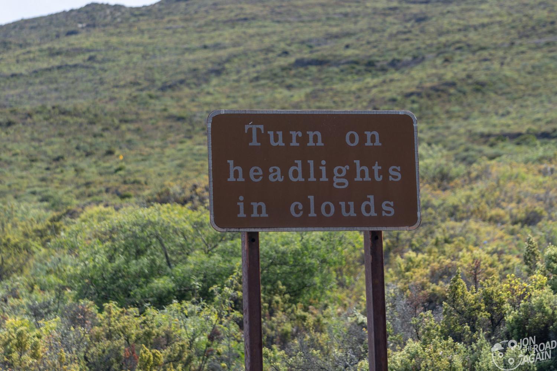 Haleakala Sign: Turn on headlights in the clouds